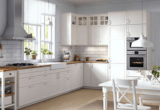 white kitchen floating fan wood counters