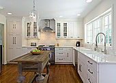 bright sunny kitchen white cabinets wood island